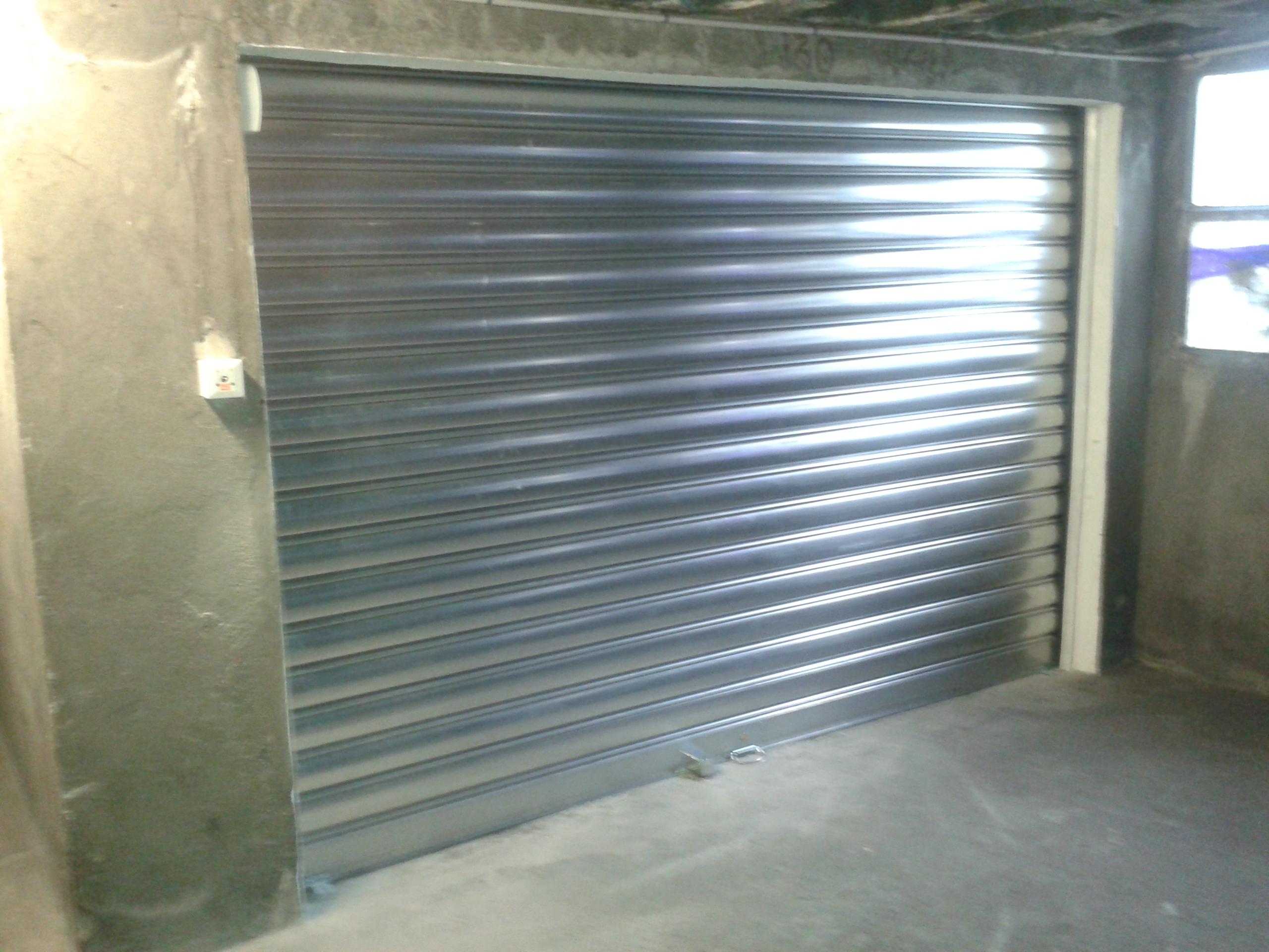 Rideaux m talliques entreprise guillot serrurier for Rideau electrique garage